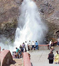 a photo of the La Bufadora blowhole sending geysers of water high into the air