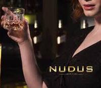 Nudus print logo in gold with a woman lifting a glass in salute