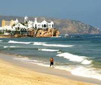 mazatlan beach with Valentino's night club castle