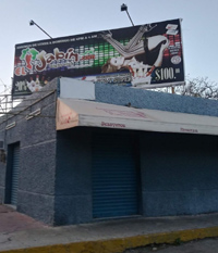 foto shows a billboard for Merida strip club El Jabin