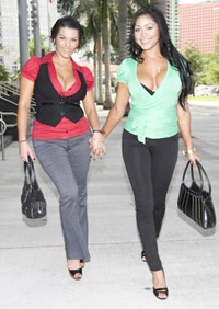 clothed escorts arriving at the hotel for a threesome