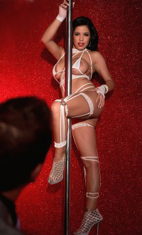Busty Mexican stripper working the pole in white bra, panties and stockings