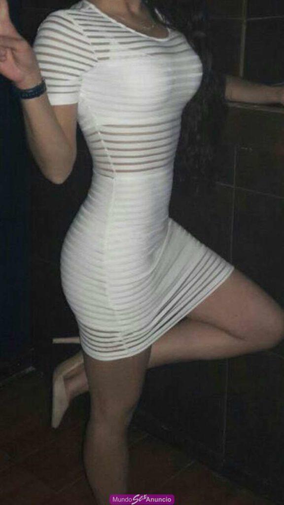 slender escort in a tight white dress