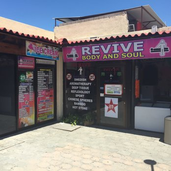 Cabo massage parlor with porn purple sign