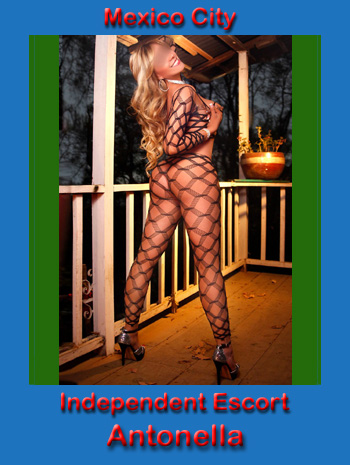 Antonella naked but for a see through body stocking