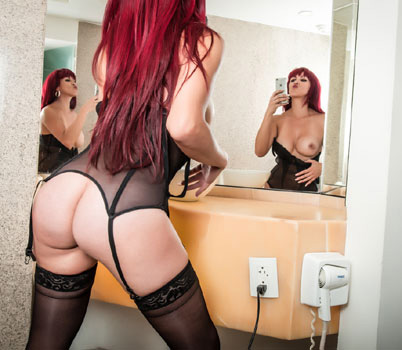 redhead anal hooker in front of a 3-way mirror