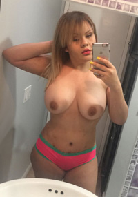 topless busty Monterrey girl checks herself out