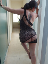 marilyn wearing a black patterned body stocking