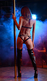 naked dancer with black thigh high leather boots