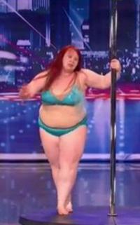 a 230 pound female stripper in a green bikini
