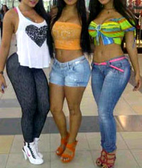 three hot young brothel whores dressed in tight jeans and revealing tops