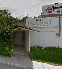 photo showing the bougainvillea covered entrance to Antorchas brothel