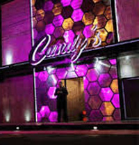 Candy's strip club outside at night with purple lights