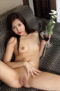 naked escort laying on the couch, legs spread