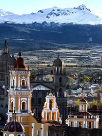 spectacular landscape showing tall cathedrals dwarfed by massive snow capped mountains